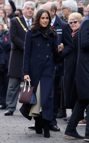 Meghan Markle paired her coat with a two-tone leather tote by Strathberry.