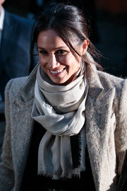 Meghan Markle stayed warm with a taupe Jigsaw scarf teamed with a wool coat while headed to Reprezent 107.3 FM.