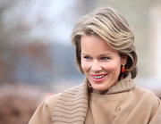 Princess Mathilde wears her wavy hair in a classic side-part.