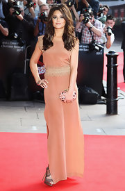Cheryl wore a peach evening dress with gold embroidery for the Prince's Trust Awards in London.