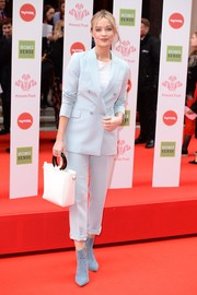 Laura Whitmore suited up in a baby-blue jacket and pants combo for the Prince's Trust, TKMaxx and Homesense Awards.