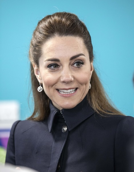 Kate Middleton wore her hair in a simple half-up style while visiting Leicestershire.