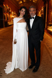 Amal Clooney looked supremely elegant in an asymmetrical white gown at the Prince's Trust dinner.