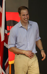 Prince William wore a light-weight checkered button-down with his tan pants for his visit to Australia.