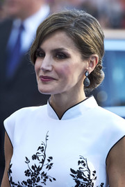Queen Letizia of Spain complemented her stylish updo with a pair of teardrop earrings.