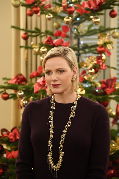 Charlene Wittstock punctuated her dark outfit with a beautiful pearl necklace for the Christmas gifts distribution at La Croix Rouge in Monte Carlo.