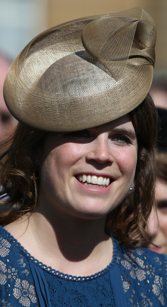 Princess Eugenie Decorative Hat [royal society for the prevention of accidents centenary garden party,centenary garden party,hair,hat,hairstyle,smile,chin,lip,headgear,fashion accessory,fun,fedora,buckingham palace,london,eugenie of york]