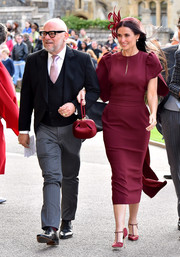 Demi Moore looked ladylike in a burgundy midi dress by Stella McCartney at Princess Eugenie's wedding.