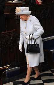 Queen Elizabeth attended Princess Eugenie's wedding wearing a pale blue coat with gold buttons.