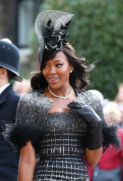 Naomi Campbell kept her hands warm in black leather gloves while attending Princess Eugenie's wedding.