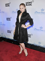 Sofia Vassilieva posed for the camera in a sleek black trenchcoat at the Princess Grace Awards Gala.