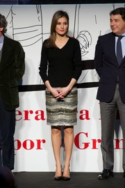Princess Letizia kept it simple up top in a black V-neck sweater during the Barco de Vapor Literature Awards.