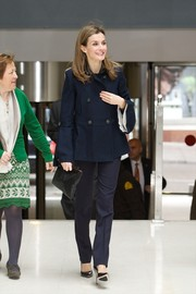 Princess Letizia was classic and sophisticated in a navy pea coat during the Forum Against Cancer.