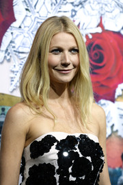Gwyneth Paltrow kept her customary center-parted hairstyle when she attended the Printemps Haussmann Christmas decoration launch.