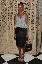 Shala Monroque chose a textured black pencil skirt to pair with her top.