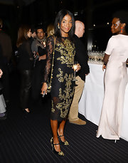 Genevieve Jones wore a regal black lace dress with gold scroll embroidery at the 50th New York Film Festival.