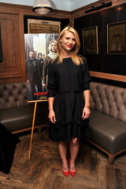 Claire Danes wore red Kurt Geiger pumps with her LBD for a splash of color.