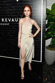 Madelaine Petsch polished off her look with a pair of metallic sandals.