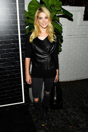 Ashley Greene made an appearance at the Prive Revaux launch wearing a black leather vest over a matching shirt.