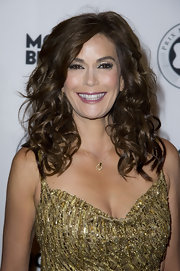 Teri Hatcher wore her super shiny hair in a mass of lovely long bouncy curls at the Prix Montblanc 2011.