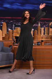 Priyanka Chopra teamed her dress with a pair of black PVC cap-toe pumps.
