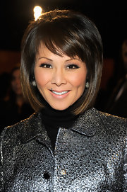 Alina Cho wore her hair in a sleek layered bob with wispy side-swept bangs at the Proenza Schouler fall 2012 fashion show.
