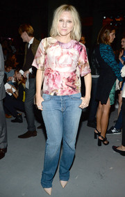 Laura Brown contrasted her girly top with tomboy-chic jeans.