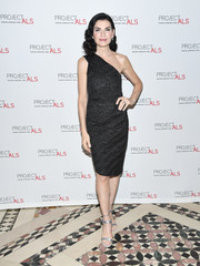 Julianna Margulies styled her dress with silver ankle-strap sandals.