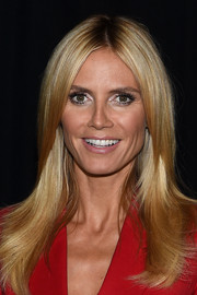 Heidi Klum sported a glossy center-parted 'do at the 'Project Runway' fashion show.
