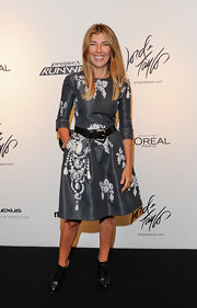 Nina Garcia cut a feminine silhouette in this gray print cocktail dress at the 'Project Runway' Season 10 wrap party.