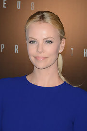 Charlize Theron swept on a soft peachy-beige lipstick followed by a touch of gloss for the premiere of 'Prometheus.'