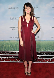 Rosemarie looked striking in this beautifully pleated Merlot cutout dress at the NY premiere of 'Promised Land.'