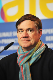 A cool striped scarf added some color to Gus Van Sant's black sweater.