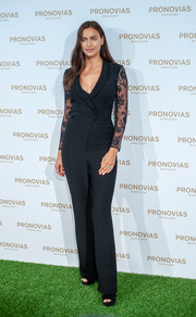 Irina Shayk attended the Pronovias Bridal photocall wearing a black lace-sleeve jumpsuit from the label.