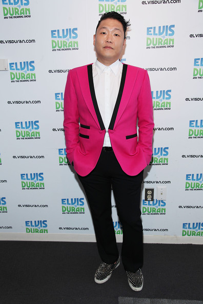 Psy chose a pair of classic black pants to pair with his quirky pink blazer.