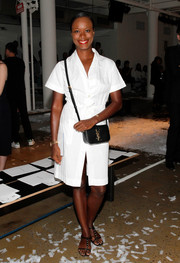 Shala Monroque complemented her outfit with a classic black YSL shoulder bag.