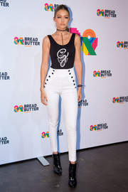 Gigi Hadid sported a Tommy Hilfiger ensemble, consisting of a black tank top and white skinnies, at the Puma fashion show.