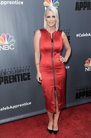 Carrie Keagan flaunted her shapely figure in a body-con red zip-up dress at the Q&A for 'The New Celebrity Apprentice.'