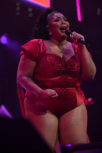 Lizzo slipped into a beaded red bodysuit for her performance at Q102's Jingle Ball 2019.