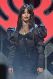 Camila Cabello performed at Q102's Jingle Ball 2018 wearing a fitted black top with puffed sleeves and a sheer, embellished yoke.