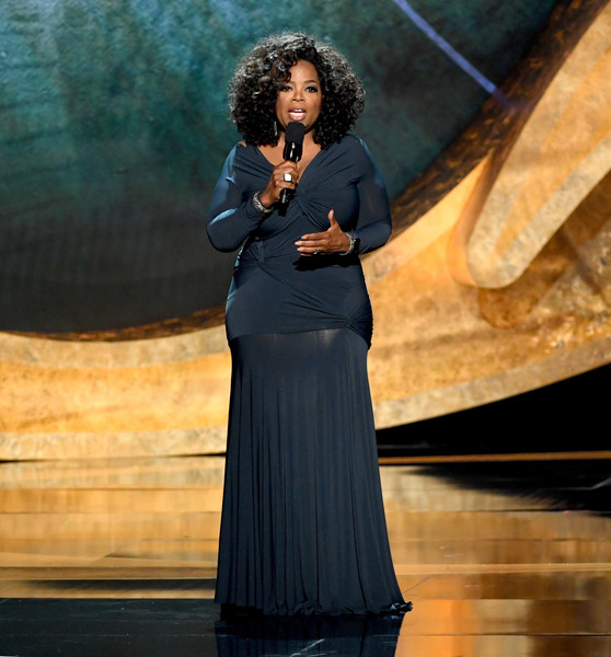 Oprah Winfrey spoke onstage at the Q85: A Musical Celebration for Quincy Jones wearing a navy twist-detail gown.