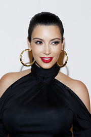 Kim Kardashian attended the QVC Red Carpet Cocktail Party wearing a vivid shade of scarlet lipstick.