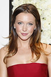 Katie Cassidy attended a QVC cocktail party wearing her shiny tresses in lots of layers.
