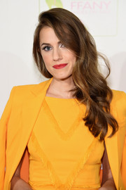 Allison Williams was glamorously coiffed with this curly side sweep when she attended the FFANY Shoes on Sale event.