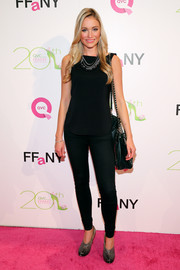 Katrina Bowden flaunted her shapely legs in a pair of black skinny jeans during the FFANY Shoes on Sale event.