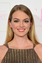 Lindsay Ellingson attended the FFANY Shoes on Sale event wearing her hair loose and straight with an off-center part.