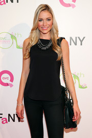 Katrina Bowden went casual at the FFANY Shoes on Sale event with this black tank top and jeans combo.
