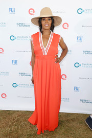June Ambrose looked breezy in a sleeveless orange maxi dress during Super Saturday Live.