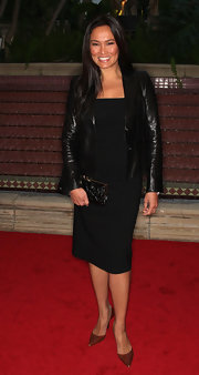 Tia Carrere added subtle color to her QVC ensemble with a pair of red pointy pumps.