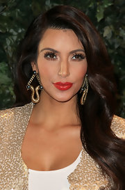 Kim spiced up her gold sequin jacket with decorative chain embellished earrings.
